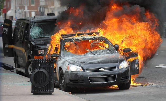 A Maryland Transit Authority patrol car burns at North and Pennsylvania Avenues on Monday, April 27, 2015, Baltimore, MD, USA. Photo by Jerry Jackson/Baltimore Sun/TNS/ABACAPRESS.COM