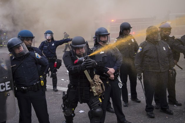 BALTIMORE, MD - APRIL 27: Officers pepper spray people near West North Avenue and Pennsylvania Avenue during a protest for Freddie Gray in Baltimore, MD on Monday April 27, 2015. Gray died from spinal injuries about a week after he was arrested and transported in a police van. (Photo by Jabin Botsford/The Washington Post via Getty Images)